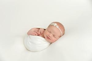 Wrapped newborn, white, newborn smile, poses