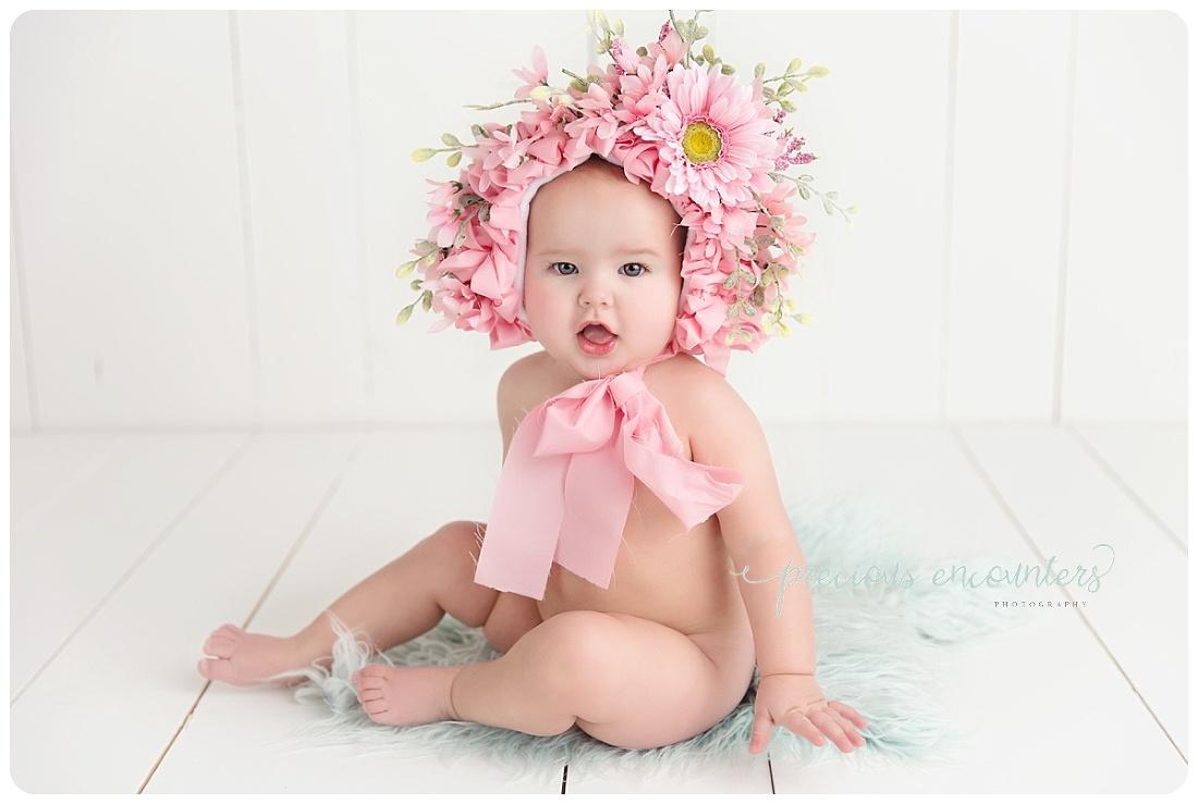 teal, white backdrop, wood, flower bonnet