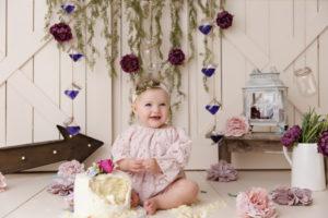 girl, cake smash, flowers, purple, arrow, barn doors, vintage, rustic, Colorado Springs